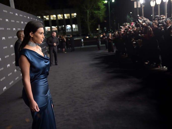 Kanye West  and Kim Kardashian attend the 2014 LACMA