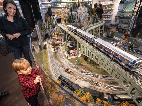 A young train enthusiast delights at the New York Transit Museum's 16th Annual Holiday Train Show in Grand Central Terminal in New York City.