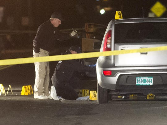 Vermont State Police investigators video the scene of the shooting of Anna Alger in St. Albans in September 2013.