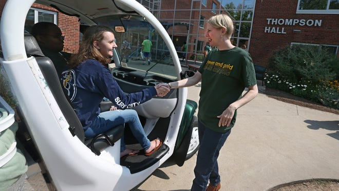Dr. Heidi Macpherson, president of the College at Brockport, welcomes incoming freshman Grace Tychinski, 17, of Orchard Park.