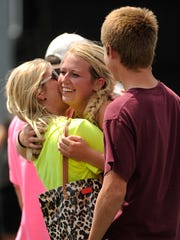 Northside's Jobee White (center) gets a hug from her mother, Jana, after winning the Class 1A girls singles state championship match over Menard's Claudia Jiminez-Garcia at the UIL State Tennis Championships on Thursday, May 18, 2017, at the George P. Mitchell Tennis Center in College Station. White won the match 7-6(2), 6-1.
