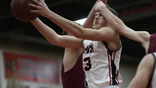 SPASH's Drew Blair gets hit in the forehead as a foul is called during the game between SPASH and De Pere in Stevens Point Tuesday, December 6, 2016. SPASH won 72-63.