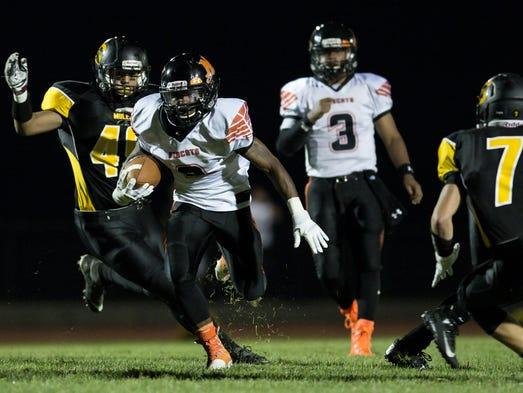 Northeastern's Anu Johson breaks a long run for a touchdown