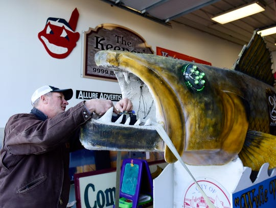 Don Clemons of Port Clinton inspects Wylie Walleye