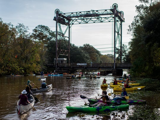 Boaters paddle canoes and kayaks on Bayou Teche in Breaux Bridge in this Nov. 27, 2015, file photo.