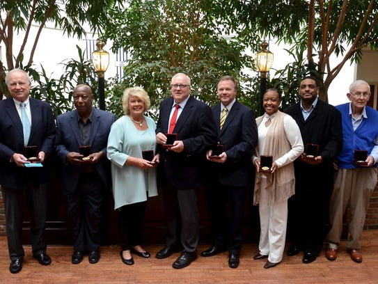 The Metro Nashville Public Schools Sports Hall of Fame inducted eight new members on Thursday: From left, Donelson's Jim Bevans, Pearl's James Armstrong, Litton's Carol Galloway, Donelson's Steve Burger, Antioch's Joe Fisher, Glencliff's Felicia Grinter, Overton's Keith Davis and East's Danny Gibson
