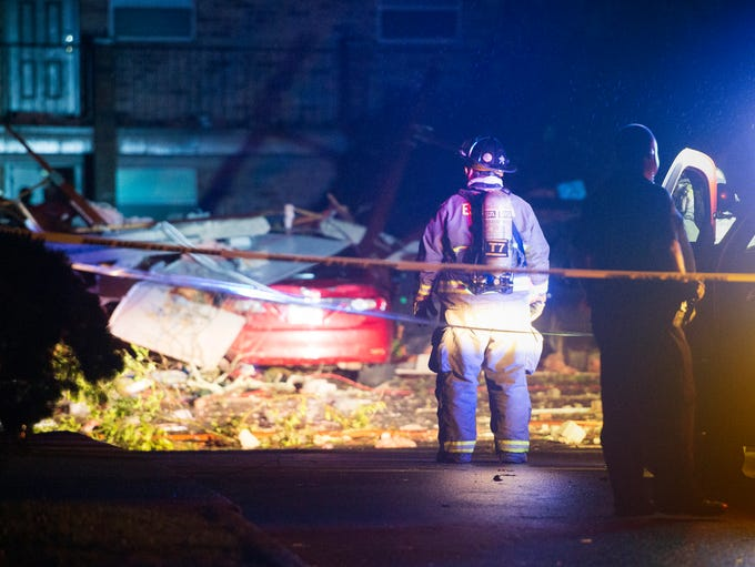 First responders inspect damage at the Moorings Apartments