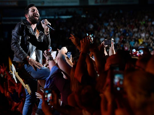 Matthew Ramsey of Old Dominion interacts with the crowd as the band performs during the CMA Music Festival on June 10, 2017, at Nissan Stadium in Nashville.
