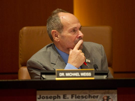 Indian River County Hospital District Trustee Michael Weiss listens to discussions in 2013 during the Hospital District Board Meeting at the County Administration Building in the Commission Chambers in Vero Beach.