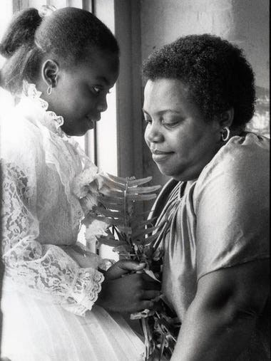 May 7, 1982: Stephanie McDuffie 7, with flowers for