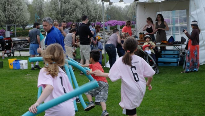 Children enjoy the fun and games at Waterfront Park during the annual Kids Day in Burlington.
