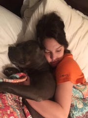 Anna Cupit and her dog Asher, sound asleep.