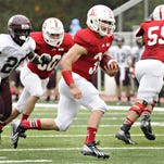St. John's Sam Sura takes the ball toward the goal line to score against Augsburg in the first quarter on Oct. 12.