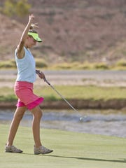 Snow Canyon golfer Lexi Hamel celebrates after sinking