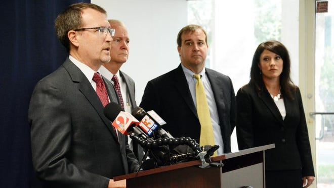 State Attorney Phil Archer announces the arrest of former Clerk of Courts Mitch Needelman on bribery and tampering charges. Behind Archer are Wayne Holmes, Bill Respess and Laura Moody all with the state attorney's office.