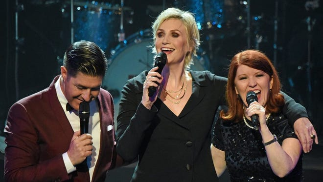Jane Lynch (center)  with Kate Flannery (right) and Tim Davis.