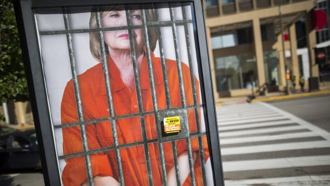 A poster of Hillary Clinton behind bars outside the Republican convention on July 18, 2016, in  Cleveland.