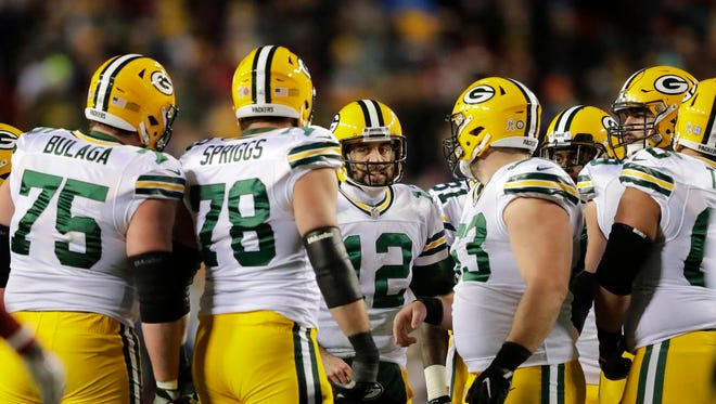 Green Bay Packers quarterback Aaron Rodgers huddles up the team against Washington in the third quarter Sunday, November 20, 2016, at FedEx Field in Landover, Maryland.