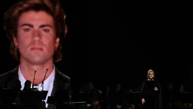 British singer Adele performs a tribute to late George Michael onstage during the 59th Annual Grammy music Awards on February 12, 2017, in Los Angeles, California.