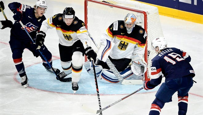 Team USA forwards Christian Dvorak, left, and Clayton Keller in action against German defender Denis Reul and goalie Thomas Greiss during their 2017 IIHF World Championships game Friday.