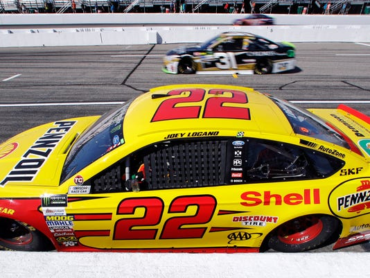 Joey Logano sits in his car during an afternoon practice for the NASCAR Cup Series 300 auto race at New Hampshire Motor Speedway in Loudon, N.H., Saturday, Sept. 23, 2017. Logano was penalized by officials for inspections violations and forced to sit parked on pit row for the entire practice. (AP Photo/Charles Krupa)