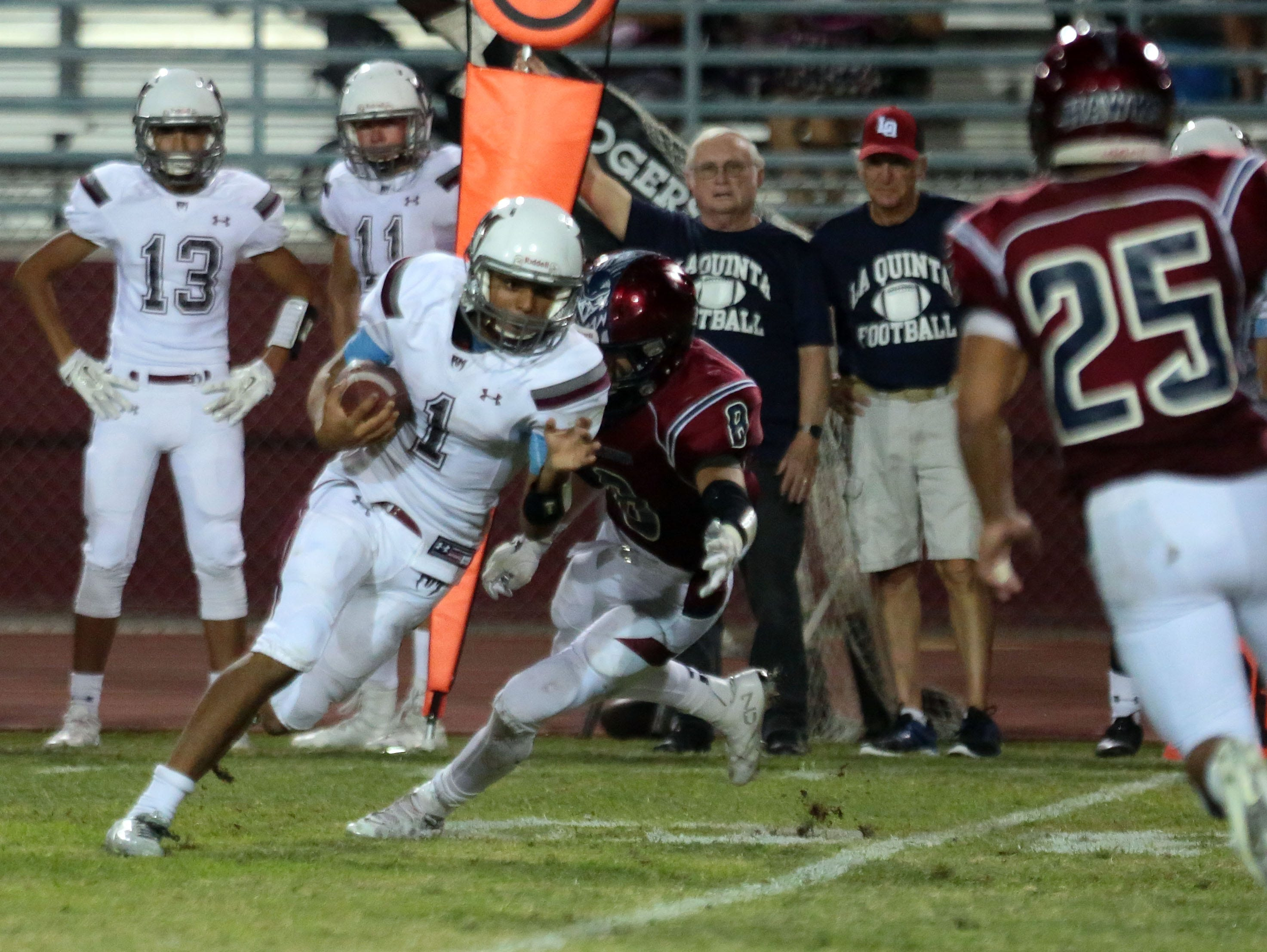 Rancho Mirage's Marques Prior starts his touchdown run against La Quinta in the second quarter on Friday, September 9, 2016 in La Quinta.