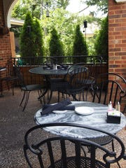 The breezy patio, with its thoughtfully placed landscaping,