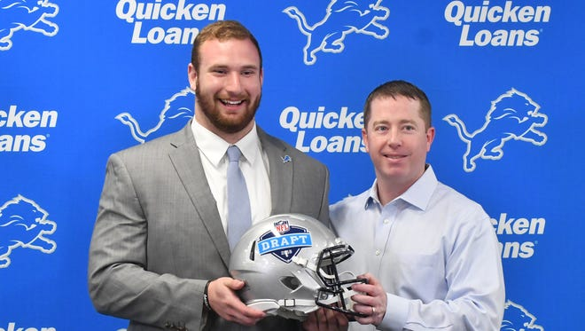 Lions first-round pick Frank Ragnow, left, is introduced with GM Bob Quinn at the team's practice facility on Friday.