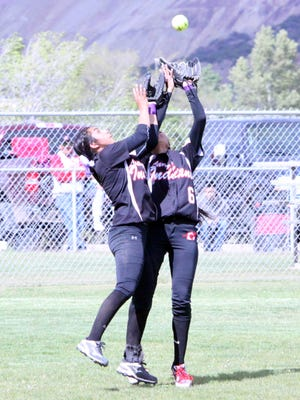 Marisa Ray, left, and Eliza Ortiz, centerfield, collide to make a great catch during the first game of a doubleheader against Silver on Friday evening at Tom Powers Field.