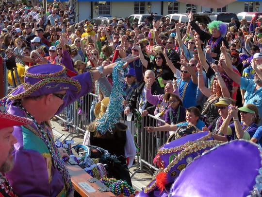 Thousands of people hit Pensacola Beach for the Krewe