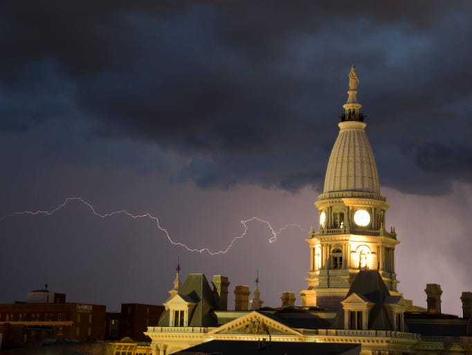 Lightning streaks across the sky behind the Tippecanoe County Courthouse Tuesday, August 19, 2014, in Lafayette. A cold front moved through the area causing the lightning storm.