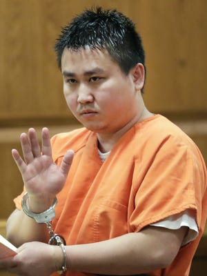 Ger Thao, 29, of Appleton, waves to his family after being sentenced Wednesday to 10 years in prison. Thao was convicted of an April 2017  shooting at an apartment complex on the north side of Appleton. Wm.Glasheen/USA TODAY NETWORK-Wisconsin