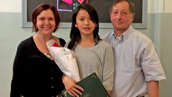 Karen Geer with daughter Molly and husband Paul Friedman