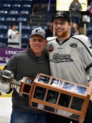 Kevin Meier (left) and his son, Spencer, hold the United States Hockey League's Clark Cup on May 19 in Youngstown, Ohio, after the Fargo Force won the deciding game in the championship series. Meier, a St. Cloud State recruit, is 19-year-old defenseman from Sartell.