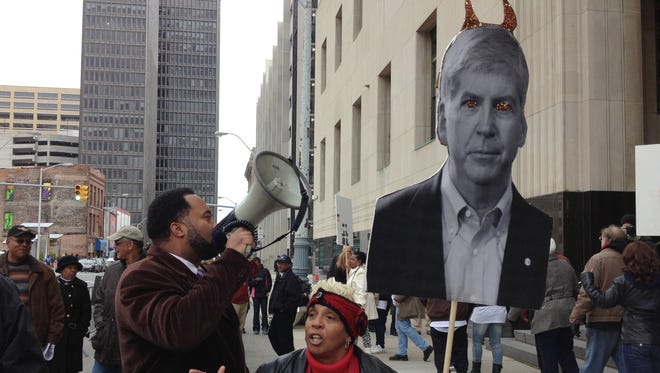 Protesters show outside federal court in Detroit during the city's bankruptcy eligibility trial Oct. 28, 2013.