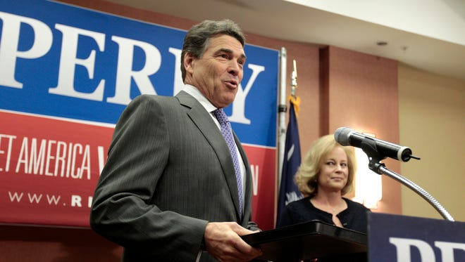 Texas Gov. Rick Perry and his wife, Anita, at his news conference withdrawing from the 2012 presidential race.