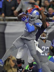 Quandre Diggs intercepts a pass intended for Bears receiver Dontrelle Inman during the fourth quarter of the Detroit Lions' 20-10 win on Dec. 16, 2017, at Ford Field.