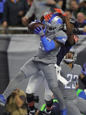 Lions S Quandre Diggs intercepts a pass intended for Bears WR Dontrelle Inman during the fourth quarter of the Lions' 20-10 win on Saturday, Dec. 16, 2017, at Ford Field.