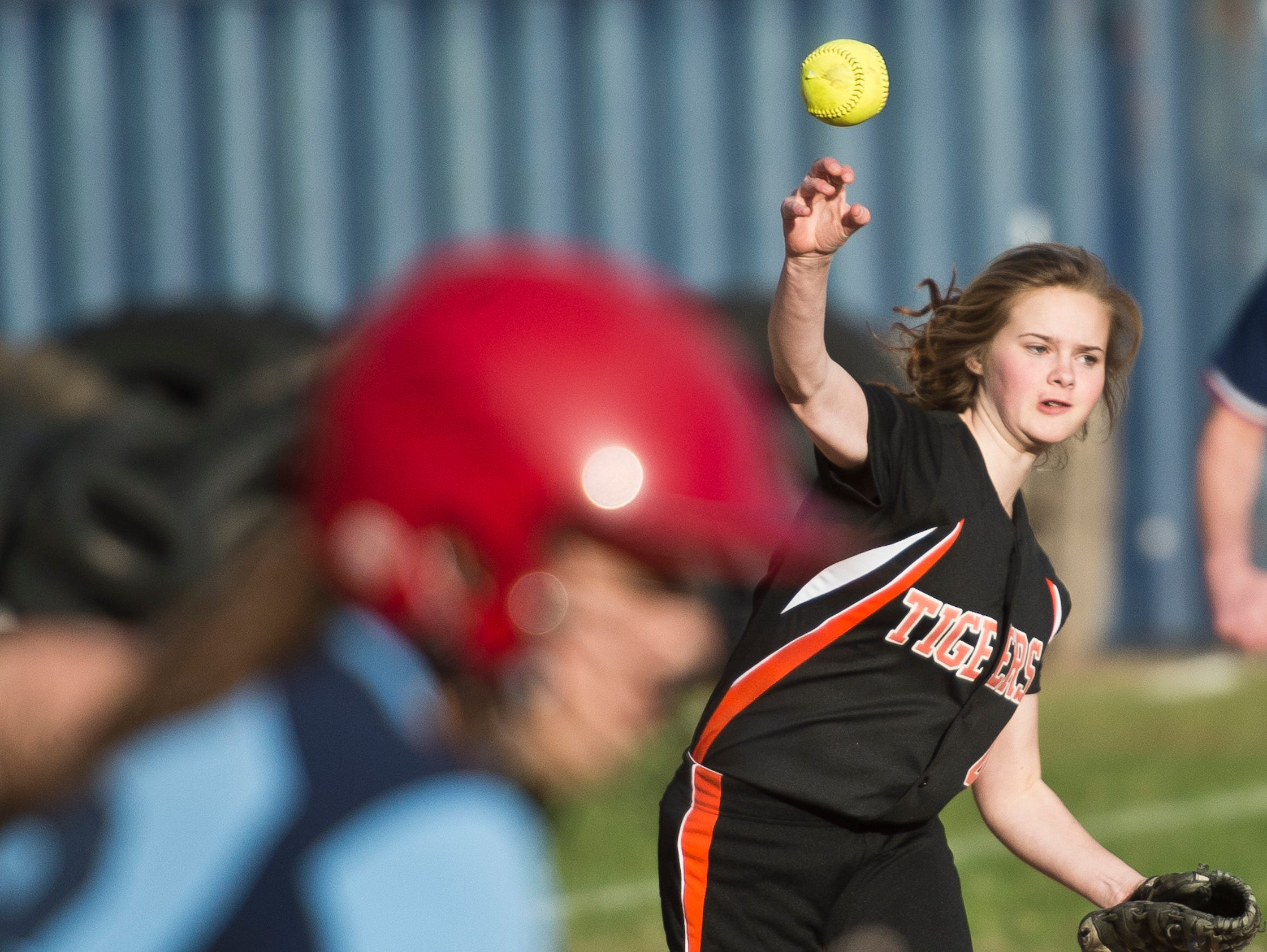 Middlebury's Darcy Staats fields a hit off Mount Mansfield's Felicia Forsyth, making the throw to first for the out during their softball game on Tuesday in Jericho.