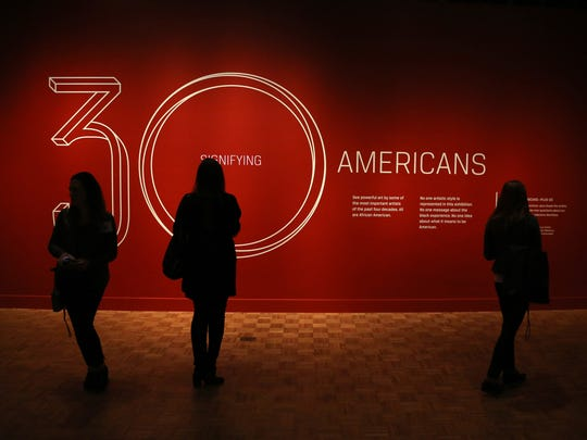 "People enter the ""30 Americans"" exhibit during the"