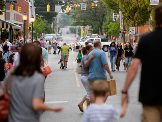 People walk up and down North Beaver Street for First
