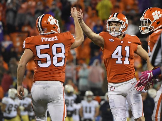Clemson place kicker Alex Spence (41) kicks a field