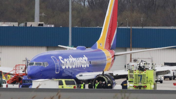 A Southwest Airlines jet sits on the runway at Philadelphia