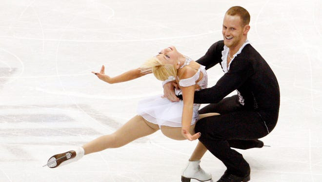 Caydee Denney and John Coughlin of the United States perform in the pairs free skate event at the 2013 Skate America figure skating competition at Joe Louis Arena on Oct. 20.
