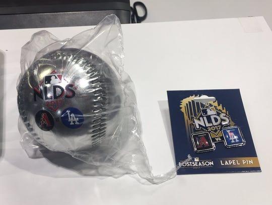 National League Division Series lapel pins and balls