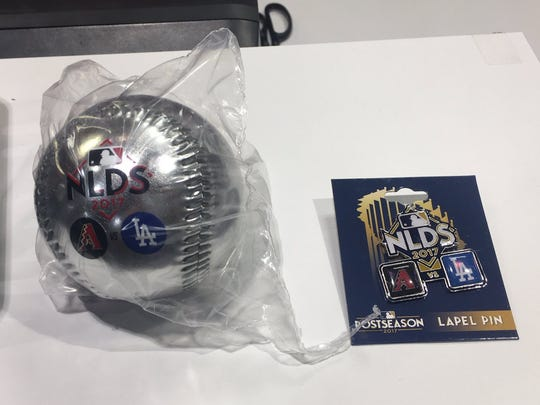 National League Division Series lapel pins and balls were available inside Chase Field Oct. 9, 2017.