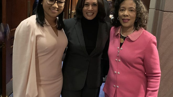 Alpha Kappa Alpha Sorority Inc. International First Vice President Danette Anthony Reed (right, in pink) shares a moment with Sen. Kamala Harris (center) and AKA International Second Vice President Kasey A. Coleman during a 2020 Congressional Black Caucus Emergency Meeting.