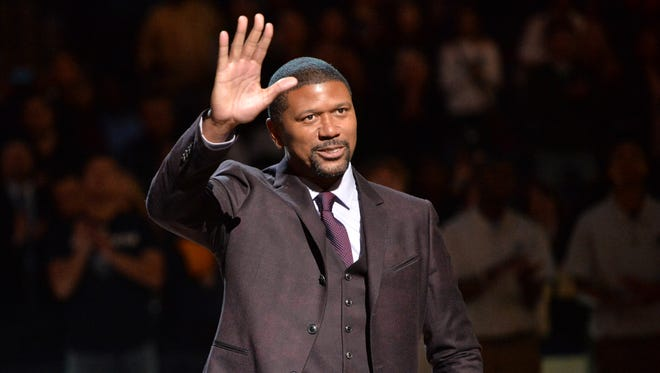 Former Michigan basketball player Jalen Rose receives the 11th annual National Civil Rights Museum Sports Legacy Award before an NBA game Jan. 18, 2016, in Memphis, Tenn.