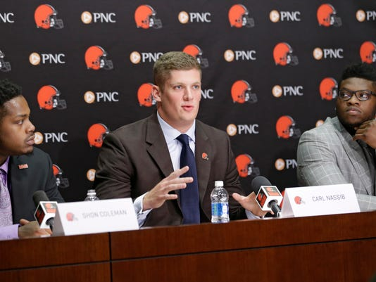 Cleveland Browns Carl Nassib, center, speaks at a news conference at the NFL football team's training camp facility, Saturday, April 30, 2016, in Berea, Ohio. Shon Coleman, left, and Emmanuel Ogbah, right, listen. (AP Photo/Tony Dejak)
