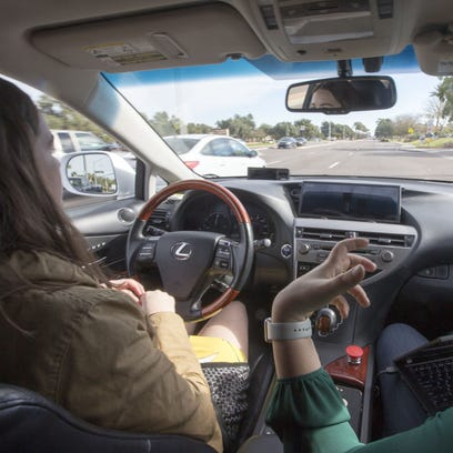 Driver Priscilla Knox and Jaime Waydo, a Waymo engineer,